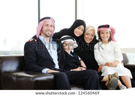 Arabic Muslim father and mother with sons daughter - stock photo