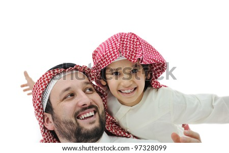 Arabic Muslim father and son, happy family - stock photo