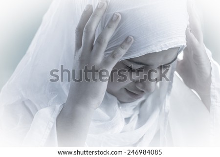 Arabic Muslim Middle Eastern girl wearing white - stock photo