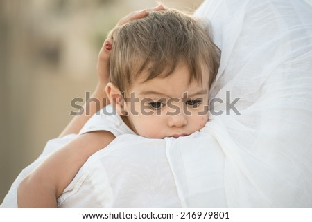 Arabic Muslim Middle Eastern woman with baby - stock photo