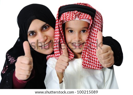 Arabic Muslim mother and son with thumb up - stock photo
