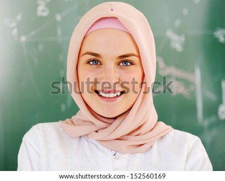 Arabic Muslim teenage student inside the high school classroom posing on board - stock photo