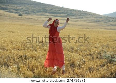 Arabic people enjoying on beautiful field - stock photo