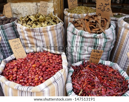 Arabic priced and labeled sacks of spices in a shop in Amman, Jordan, Middle East, Eastern Mediterranean - stock photo