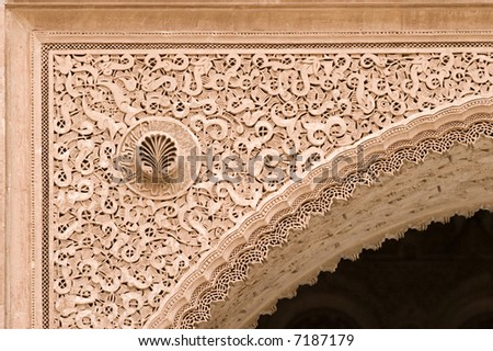 arabic sculpted archway detail in morocco, ben youssef medersa, marrakesh - stock photo
