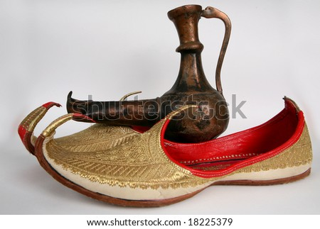 Arabic slippers and Aladdin Lamp. - stock photo