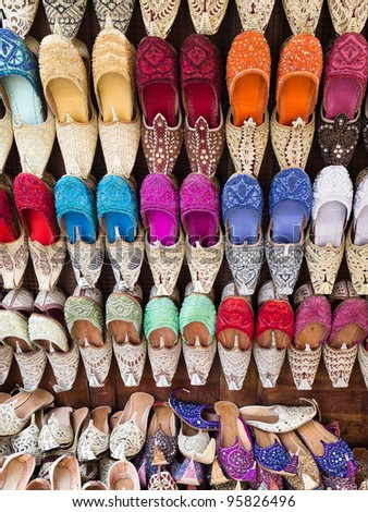 Arabic slippers in a street shop - stock photo