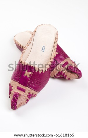 Arabic slippers on white background - stock photo