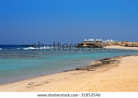 Arabic style seafood restaurant on the golden beach of Egypt - stock photo