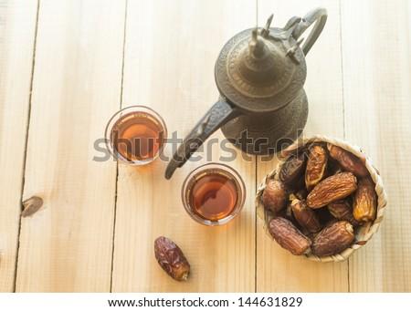Arabic sulemani tea with dates - stock photo
