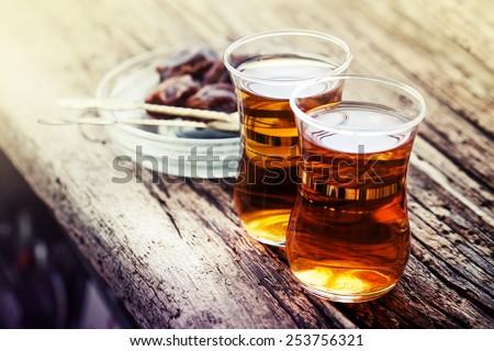 Arabic sweet and tea still life/ An close up of an islamic tea cups - stock photo