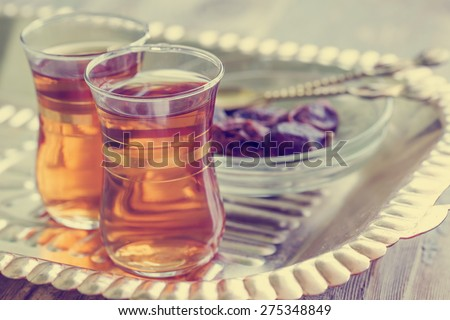 Arabic sweet and tea still life/ An close up of an islamic tea cups - stock photo