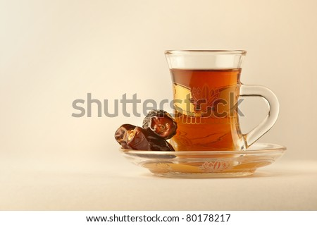 Arabic tea and dates - stock photo