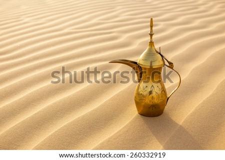 Arabic tea pot on Desert - stock photo