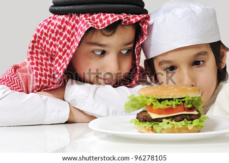 Arabic two little kids with big Burger