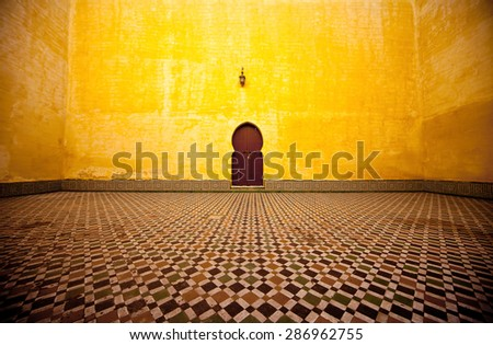 Arabic typical entry on a yellow wall - stock photo