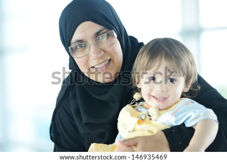 Arabic woman with her baby portrait - stock photo