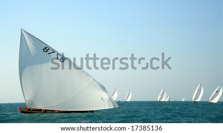 Arabic Wooden Sailing Dhows Competing In The Arabian Ocean - stock photo