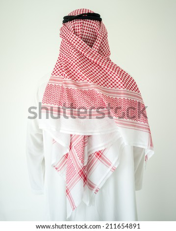 Arabic young businessman posing from back - stock photo