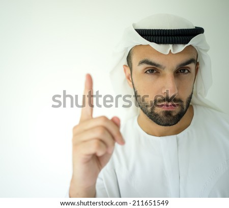 Arabic young businessman posing with finger up for idea - stock photo