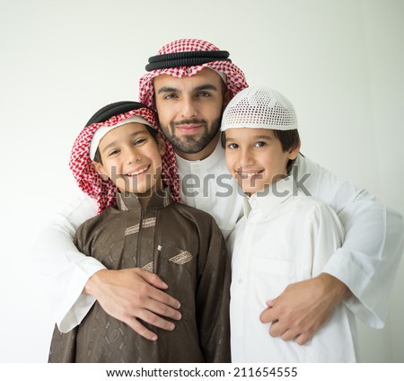 Arabic young father posing with kids - stock photo