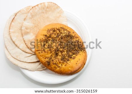 Arabic Zaatar bread and Kuboos bread  in a plate on white background