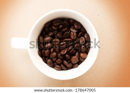arabica coffee beans and cup