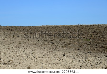 Arable land in early spring - stock photo