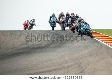 ARAGON, SPAIN - SEPTEMBER 27: Moto 3 race at GP Movistar de Aragon of MotoGP at Motorland Aragon Circuit on September 27, 2015 in Aragon, Spain. - stock photo