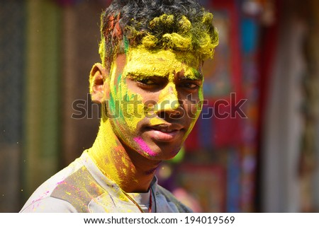 ARAMBOL, GOA, INDIA - MARCH 17: Unidentified man celebrates Holi festival in Arambol Main Street, GOA, India on March 17, 2014. It's a religious spring holiday and also known as Festival of Colours.
