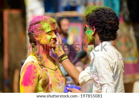 ARAMBOL, GOA, INDIA - MARCH 17: Young people celebrates Holi festival in Arambol Main Street, GOA, India March 17, 2014. It's a religious spring holiday and also known as Festival of Colours.  - stock photo