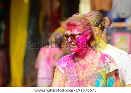 ARAMBOL, GOA - MARCH 17: Unidentified people celebrates Holi festival in Arambol Main Street, GOA, India on March 17, 2014. It's a religious spring holiday and also known as Festival of Colours. - stock photo