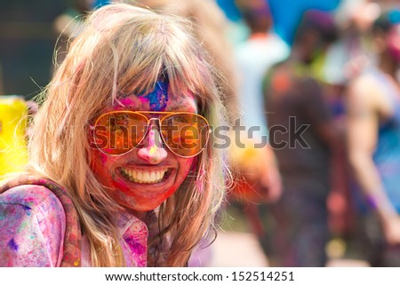 ARAMBOL, GOA - MARCH 27: Young woman celebrates Holi festival in Arambol Main Street, GOA, India on March 27, 2013. It's a religious spring holiday and also known as Festival of Colours. - stock photo