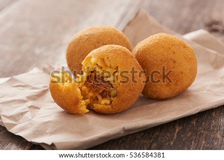 Arancini (deep fried rice balls with meat) Typical Sicilian street food
