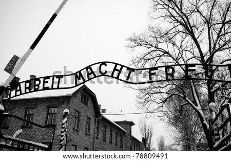 Arbeit macht frei sign (Work liberates) in concentration camp Auschwitz, Poland - stock photo