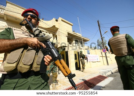 ARBIL, IRAQ -JUNE 11 : Unidentified Kurdish soldier stands guard at a check point on June 11, 2007 in Arbil, Iraq