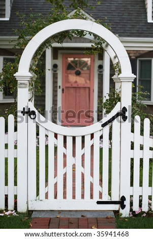 arbor gate with home in background - stock photo