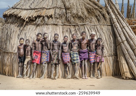 ARBORE, ETHIOPIA, 13 AUGUST:unidentified boys from Arbore tribe in Arbore, Ethiopia, on 13 august 2014. Body painting is done by the Arbore using natural colors made from soil and stone. - stock photo