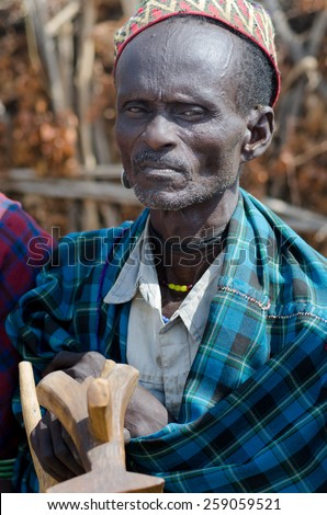 ARBORE, ETHIOPIA, 13 AUGUST: unidentified old men from Arbore Tribe on august 13, 2014. Arbore tribe people are endangered because of oil field near their villages - stock photo