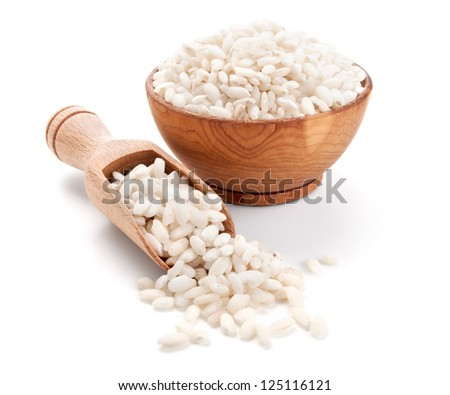 arborio rice in a wooden bowl isolated on white background - stock photo