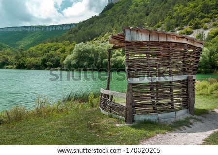 arbour ashore mountain lake in a canyon in Crimea - stock photo
