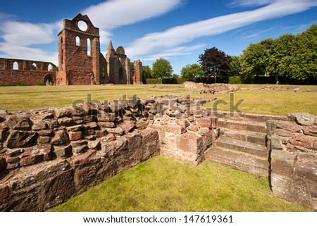 Arbroath Abbey in Angus, Scotland is a red sandstone ruin founded in 1178 by King William the Lion and most famous as the place where the Declaration of Arbroath was signed in 1320. - stock photo