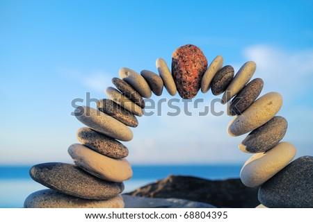 Arc crookedness of the pebbles on the seashore - stock photo