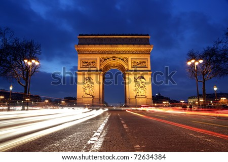 Arc de Triomphe and Champs-Elysees Avenue at night - stock photo