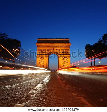 Arc de Triomphe and Champs-Elysees Avenue at night, in Paris, France - stock photo