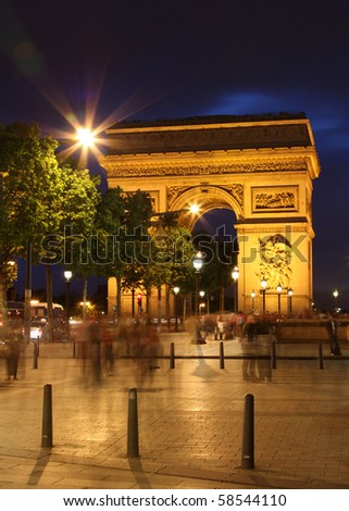 Arc De Triomphe and ghost of pedestrians - stock photo