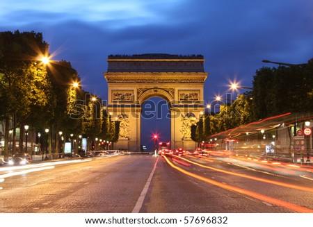 Arc De Triomphe and light trails - stock photo