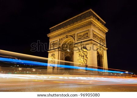 Arc de Triomphe - Arch of Triumph by night in Paris, France - stock photo