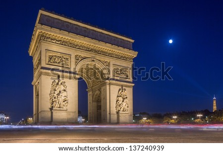 Arc de Triomphe at night in Paris France - stock photo