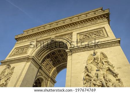 Arc de Triomphe at sunset in Paris, France - stock photo